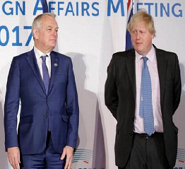 Johnson turns tough on Russia, drawing flak from all sides